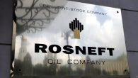 epa05664418 (FILE) A file photo dated 17 July 2014 showing the logo of the 'Rosneft' petroleum company on the wall of its headquarters in Moscow, Russia. Media reports on 07 December 2016 citing Kremlin state Russia has completed the privatization for 19,5 per cent of Rosneft.  EPA/YURI KOCHETKOV